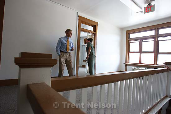 Helper - Lloyd Pendleton, Director of the Homeless Task Force for the State of Utah's Department of Community and Culture, speaks with Beth Wirtz, Vice President of Community Development Banking for Key Bank, at the Avalon House, which is being renovated into a new homeless shelter, Thursday May 28, 2009