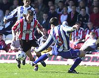 .Photo Peter Spurrier.06/04/2002.Nationwide Div 2.Brentford vs Huddersfield - Griffen Park:.Stephen Hunt go's past Garth Evans..