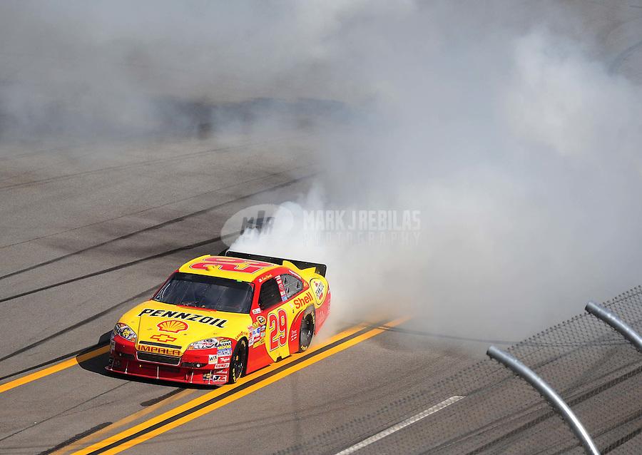 Apr 25, 2010; Talladega, AL, USA; NASCAR Sprint Cup Series driver Kevin Harvick celebrates after winning the Aarons 499 at Talladega Superspeedway. Mandatory Credit: Mark J. Rebilas-