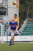 Ben Tozer of Newport County beats Jason Kennedy of Carlisle in the air during the Sky Bet League 2 match between Newport County and Carlisle United at Rodney Parade, Newport, Wales on 12 November 2016. Photo by Mark  Hawkins.
