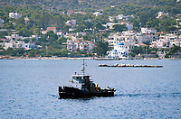"Pictured: A Coastguard vessel near the oil spill that has reached the coast of Salamina, Greece<br /> Re: An oil spill off Salamina island's eastern coast is spreading and has become ""an environmental disaster"" according to local authorities in Greece.<br /> The spill was caused by the sinking of the Aghia Zoni II tanker, carrying 2,200 metric tons of fuel oil and 370 metric tons of marine gas oil on Saturday, southwest of the islet of Atalanti near Psytalleia. According to reports, the coastline stretching from Kinosoura to the Selinia community has ""turned black"" and authorities fear a new leak from the sunken ship.<br /> According to the island's mayor, Isidora Papathanasiou, the weather ""turned on Sunday afternoon and brought the oil spill to Salamina."""