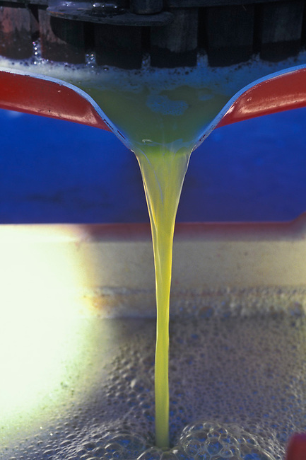 Chardonnay juice flows from press after pressing