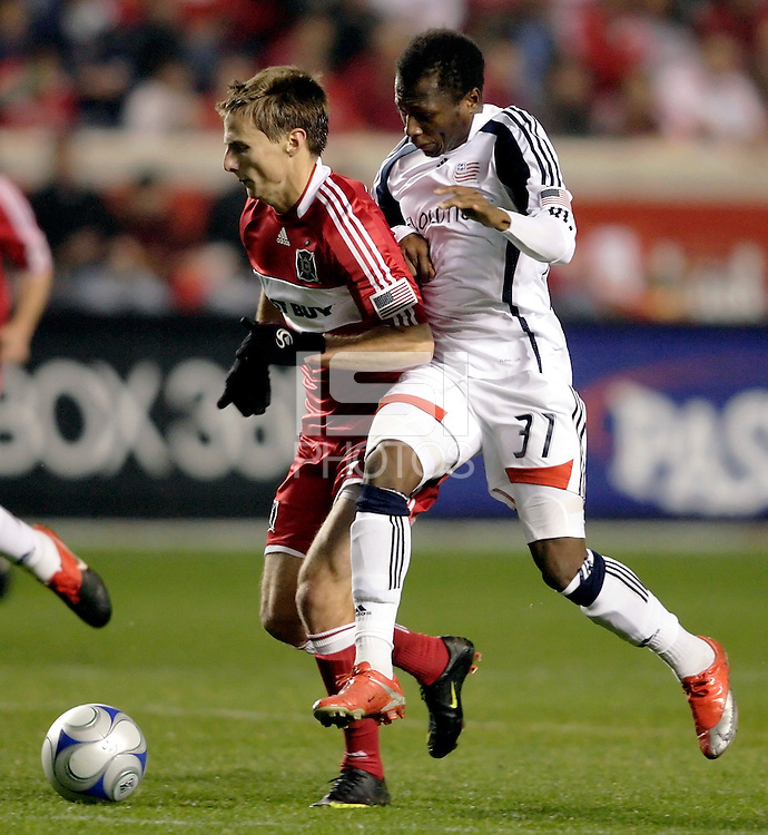 Chicago Fire midfielder Chris Rolfe (17) is pressured by New England midfielder Sainey Nyassi (31).  The Chicago Fire defeated the New England Revolution 2-0 to win their playoff series at Toyota Park in Bridegview, IL on November 7, 2009.
