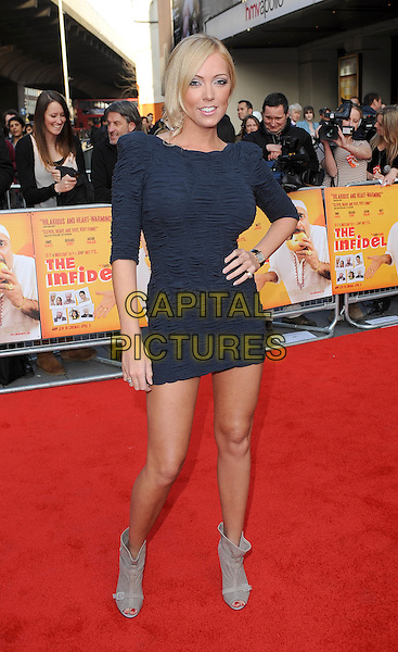 "AISLEYNE HORGAN WALLACE.The World Premiere of ""The Infidel"", Hammersmith Apollo, London, England..8th April 2010.full length black dress ruched body con hand on hip shoulder pads eighties grey gray peep toe beige ankle boots blue .CAP/BEL.©Tom Belcher/Capital Pictures."