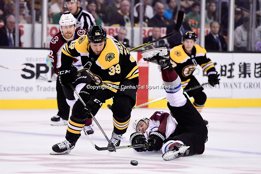 October 9, 2017: Colorado Avalanche left wing Blake Comeau (14) battles Boston Bruins left wing Matt Beleskey (39) for thepuck during the NHL game between the Colorado Avalanche and the Boston Bruins held at TD Garden, in Boston, Mass. Colorado defeats Boston 4-0. Eric Canha/CSM