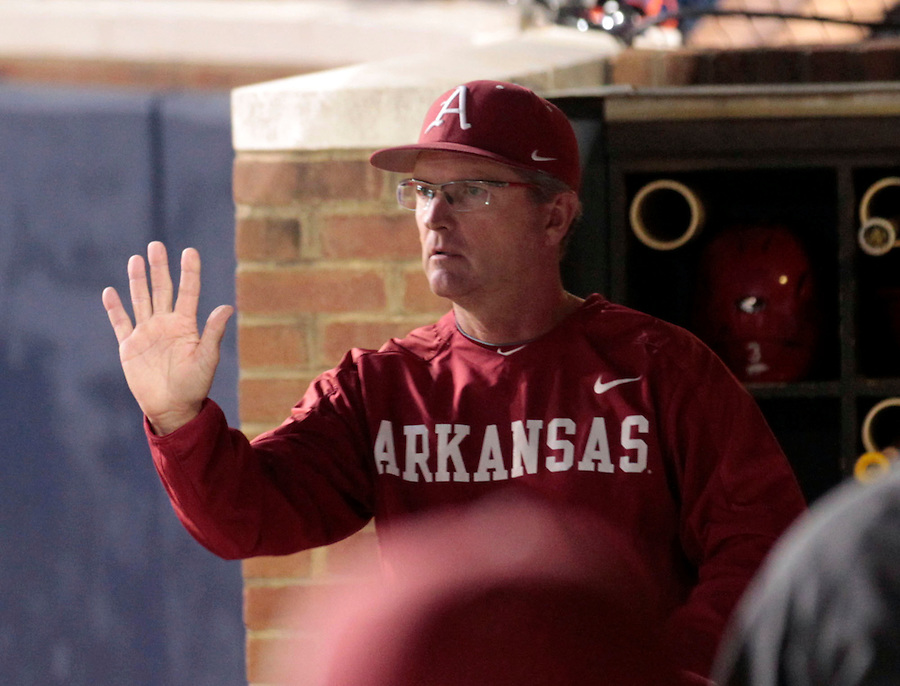 Arkansas head coach Dave van Horn signals to a player during an NCAA college baseball regional tournament game against Virginia in Charlottesville, VA., Friday, June 1, 2014. (Photo/Andrew Shurtleff)