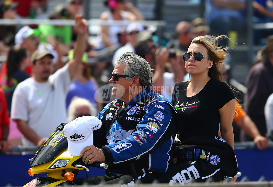 Mar 13, 2015; Gainesville, FL, USA; NHRA funny car driver John Force (left) with daughter, top fuel driver Brittany Force during qualifying for the Gatornationals at Auto Plus Raceway at Gainesville. Mandatory Credit: Mark J. Rebilas-