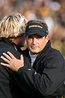 MU Head Coach Gary Pinkel stops to give a hug as he walks off the field after the game with Texas A&M at Memorial Stadium in Columbia, Missouri on November 10, 2007. The Tigers won 40-26.