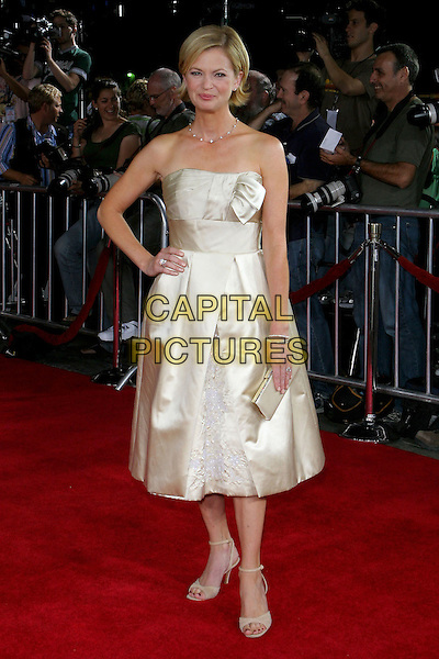 "DINA SPYBEY.At the Los Angeles Premiere of ""Just Like Heaven"" held at Graumann's Chinese Theatre,.Los Angeles, 8th Septeber 2005.full length cream satin dress strapless hand hip.Ref: ADM/JW .www.capitalpictures.com.sales@capitalpictures.com.© Capital Pictures."