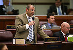 Nevada Assemblyman Paul Anderson, R-Las Vegas, works on the Assembly floor at the Legislative Building in Carson City, Nev., on Wednesday, May 13, 2015.<br /> Photo by Cathleen Allison