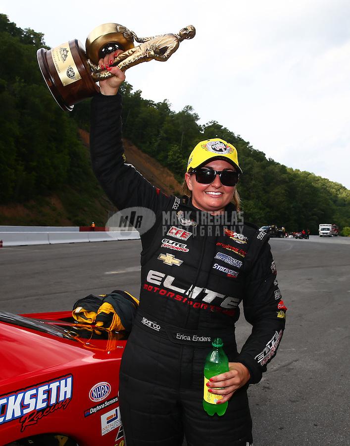 Jun 21, 2015; Bristol, TN, USA; NHRA pro stock driver Erica Enders-Stevens celebrates after winning the Thunder Valley Nationals at Bristol Dragway. Mandatory Credit: Mark J. Rebilas-