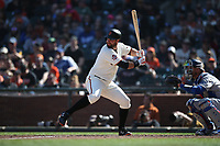 SAN FRANCISCO, CA - APRIL 8:  Brandon Belt #9 of the San Francisco Giants bats against the Los Angeles Dodgers during the game at AT&T Park on Sunday, April 8, 2018 in San Francisco, California. (Photo by Brad Mangin)