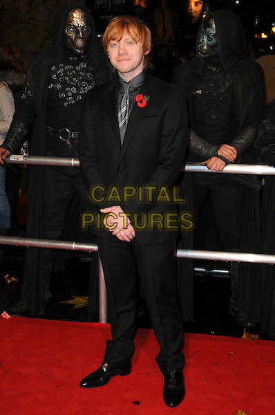 "RUPERT GRINT .""Harry Potter And The Deathly Hallows: Part 1"" World Film Premiere, Empire cinema Leicester Square and Odeon Leicester Square, London, England, UK, 11th November 2010. .full length black suit shirt tie poppy grey gray .CAP/CAS.©Bob Cass/Capital Pictures."