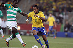 20 JUN 2010:  Robinho (BRA)(11) tries to move the ball past Emmanuel Eboue (CIV)(21).  The Brazil National Team led the C'ote d'Ivoire National Team 1-0 at the end of the first half at Soccer City Stadium in Johannesburg, South Africa in a 2010 FIFA World Cup Group G match.