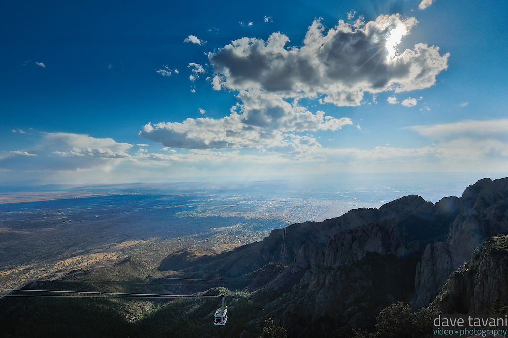 The Sandia Peak Tramway car descends from the top of the mountain toward the Rio Grande Valley.