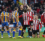 Paul Coutts of Sheffield United on the floor after a bad challenge by Abu Ogogo of Shrewsbury Town during the English Football League One match at Bramall Lane, Sheffield. Picture date: November 19th, 2016. Pic Jamie Tyerman/Sportimage