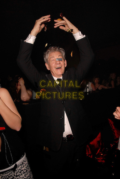 "Sir IAN McKELLEN.""The Da Vinci Code"" party at the 59th International Cannes Film Festival, Cannes, France..17 May 2006.Ref: FIN.half length arms in air dancing gesture funny black suit jacket confetti.www.capitalpictures.com.sales@capitalpictures.com.©Steve Finn/Capital Pictures"