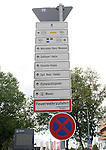 06 June 2006: Signs near Gottlieb-Daimler Stadium direct fans to their entry site by color coding in Stuttgart site of several games during the FIFA 2006 World Cup.