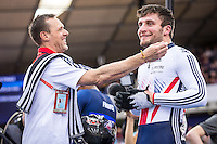 Picture by Alex Whitehead/SWpix.com - 04/03/2016 - Cycling - 2016 UCI Track Cycling World Championships, Day 3 - Lee Valley VeloPark, London, England - Great Britain's Callum Skinner defeats France's Gregory Bauge in the Men's Sprint 1/8 Finals. GB soigneur Luc De Wilde.