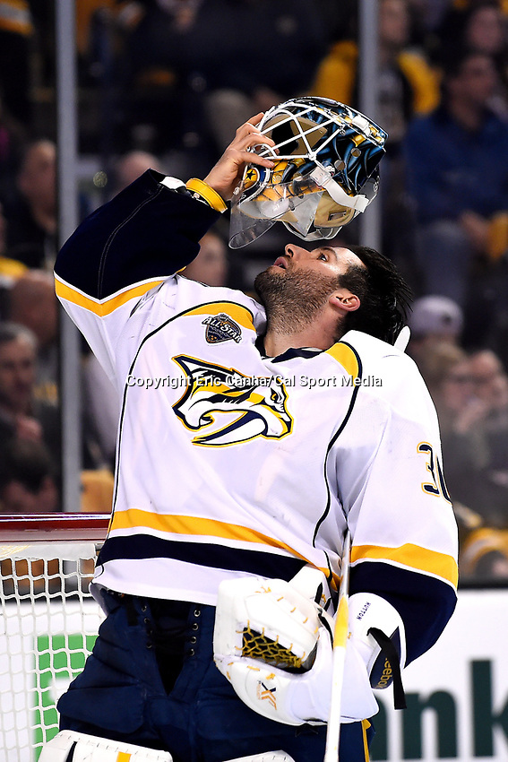Monday, December 7, 2015: Nashville Predators goalie Carter Hutton (30) puts his mask back on after a break in action during the National Hockey League game between the Nashville Predators and the Boston Bruins held at TD Garden, in Boston, Massachusetts. The Predators defeat the Bruins 3-2 in regulation time. Eric Canha/CSM