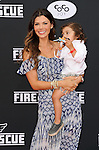 Ali Landry and son arriving at the Los Angeles premiere of Disney's Planes Fire and Rescue held at El Capitan Theatre Los Angeles, CA. July 15, 2014.
