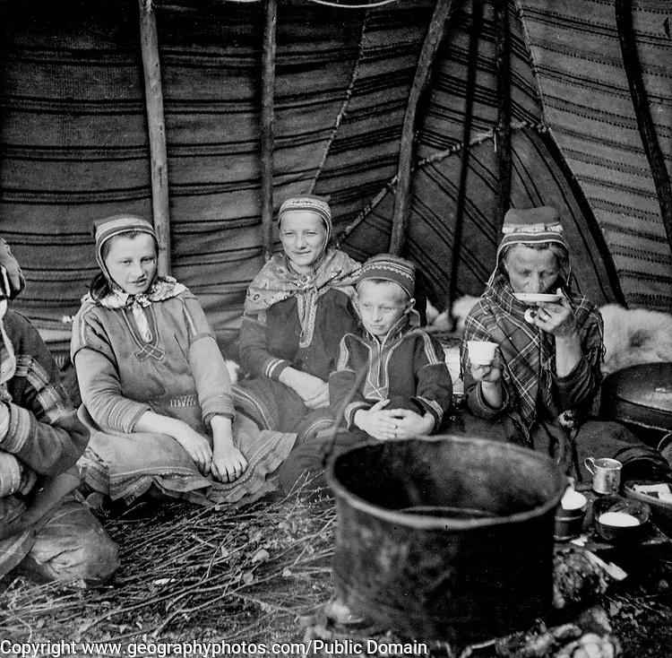 Sami women in their hut drinking coffee, Finland