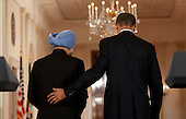 Washington, DC - November 24, 2009 -- United States President Barack Obama, right, and Manmohan Singh, India's prime minister, leave a news conference in the East Room of the White House in Washington, D.C., U.S., on Tuesday, November 24, 2009. Singh was welcomed to the White House this morning by Obama for a state visit where the two leaders will have discussions on curbing nuclear weapons, climate change and trade..Credit: Andrew Harrer - Pool via CNP