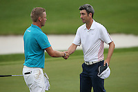 Ross Fisher (ENG) shakes hands with Morten Orum Madsen (DEN) as they complete Round Three of The Tshwane Open 2014 at the Els (Copperleaf) Golf Club, City of Tshwane, Pretoria, South Africa. Picture:  David Lloyd / www.golffile.ie