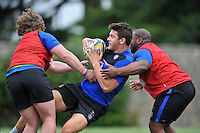 Charlie Ewels of Bath Rugby takes on the defence. Bath Rugby training session on August 4, 2015 at Farleigh House in Bath, England. Photo by: Patrick Khachfe / Onside Images