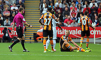 Referee Stuart Attwell walks towards David Meyler of Hull City on the grund during the Premier League match between Swansea City and Hull City at the Liberty Stadium, Swansea on Saturday August 20th 2016