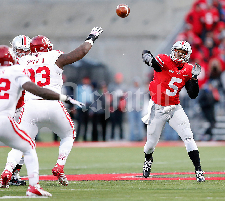 Ohio State Buckeyes quarterback Braxton Miller (5) throws a pass against Indiana Hoosiers during the second quarter of their College football game at Ohio Stadium in Columbus, Ohio on November 23, 2013.  (Dispatch photo by Kyle Robertson)
