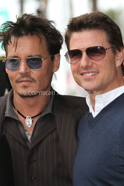 WWW.ACEPIXS.COM<br /> <br /> US Sales Only<br /> <br /> June 24 2013, LA<br /> <br /> Johnny Depp and Tom Cruise at the unveiling of Jerry Bruckheimer's star on the Hollywood Walk of Fame on June 24 2013  in Los Angeles<br /> <br /> By Line: Famous/ACE Pictures<br /> <br /> <br /> ACE Pictures, Inc.<br /> tel: 646 769 0430<br /> Email: info@acepixs.com<br /> www.acepixs.com