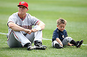 April 11, 2010:  Adam Fox of the Harrisburg Senators sits with his son before a game at Blair County Ballpark in Altoona, PA.  Harrisburg is the Double-A Eastern League affiliate of the Washington Nationals.  Photo By Mike Janes/Four Seam Images