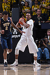 Greg McClinton (11) of the Wake Forest Demon Deacons controls a rebound late in the second half against the Pittsburgh Panthers at the LJVM Coliseum on March 1, 2015 in Winston-Salem, North Carolina.  The Demon Deacons defeated the Panthers 69-66.  (Brian Westerholt/Sports On Film)
