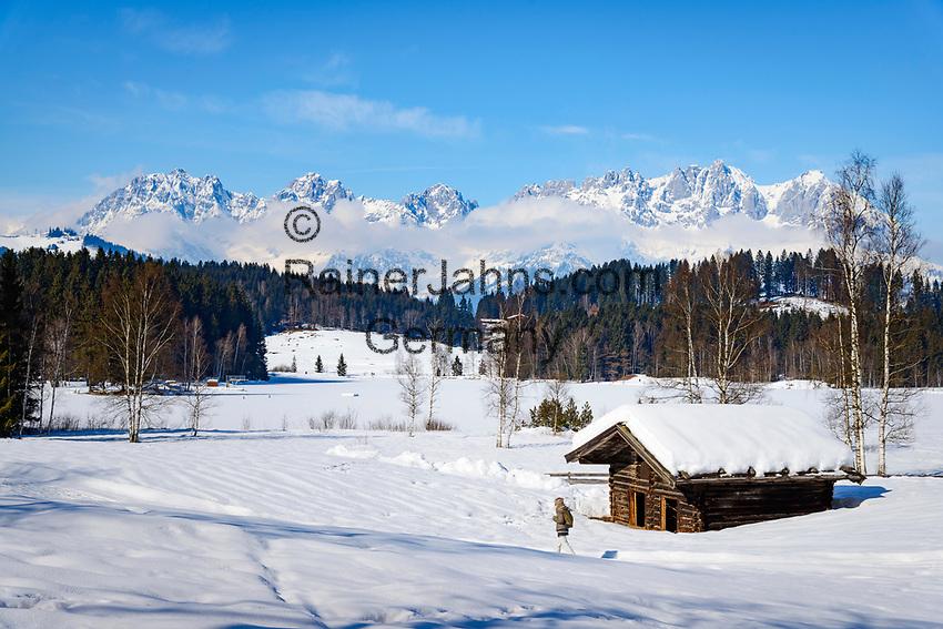 Austria, Tyrol, Reith near Kitzbuhel: idyllic Schwarzsee (Black Lake) on the outskirts of Kitzbuhel, at background Wilder Kaiser mountains | Oesterreich, Tirol, Reith bei Kitzbuehel: Schwarzsee, idyllisch gelegener See, 8 ha gross und bis zu 8 m tief, im Hintergrund das Wilder Kaiser Gebirge
