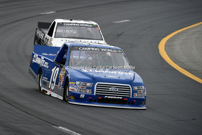 September 19, 2014 - Loudon, New Hampshire, U.S. -  Tyler Reddick, NASCAR Camping World Truck Series driver of the #19 Fraw-Tite Ford truck heads into a turn during the NASCAR Camping World Truck Series UNOH 175 race held at the New Hampshire Motor Speedway in Loudon, New Hampshire.   Eric Canha/CSM