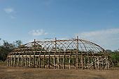 Xingu Indigenous Park, Mato Grosso State, Brazil. Aldeia Barranco Queimado. Oca under construction; framework complete.