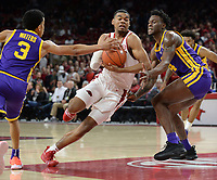 NWA Democrat-Gazette/ANDY SHUPE<br /> Arkansas forward Reggie Chaney (center) drives to the lane past LSU guard Tremont Waters (3) and forward Emmitt Williams Friday, Jan. 11, 2019, during the first half of play in Bud Walton Arena in Fayetteville. Visit nwadg.com/photos to see more photographs from the game.