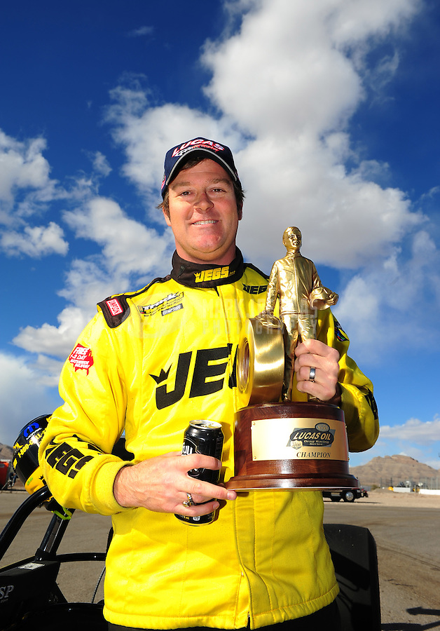Apr. 1, 2012; Las Vegas, NV, USA: NHRA super comp driver Jeg Coughlin celebrates after winning the Summitracing.com Nationals at The Strip in Las Vegas. Mandatory Credit: Mark J. Rebilas-
