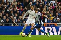 Real Madrid´s Cristiano Ronaldo and Deportivo de la Coruna's Albert Lopo during 2014-15 La Liga match between Real Madrid and Deportivo de la Coruna at Santiago Bernabeu stadium in Madrid, Spain. February 14, 2015. (ALTERPHOTOS/Luis Fernandez) /NORTEphoto.com