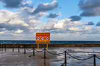 Official sign in Spanish on Havana's waterfront, the Malecon, prohibiting swimming, diving,