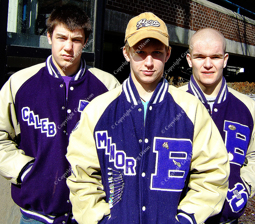 Greg Thompson, Jake Minor, and Sam Hayes (left to right) pose in Boyceville colors of purple and white before the WIAA state wrestling championships at the Kohl Center on Friday, 2/27/09