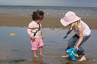 Safina and Morgan with bucket and spade on  Bettystown beach near Drogheda 2nd Aug 2007
