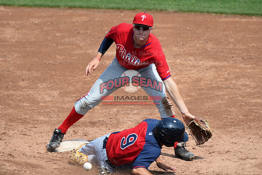 John Aiello (46) of Germantown Academy in Lansdale, Pennsylvania playing for the Philadelphia Phillies scout team reaches for a throw as Danny Blair III (9) slides in during the East Coast Pro Showcase on August 1, 2014 at NBT Bank Stadium in Syracuse, New York.  (Mike Janes/Four Seam Images)