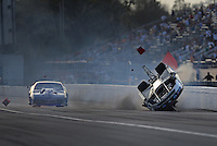 Mar. 9, 2012; Gainesville, FL, USA; NHRA pro mod driver Mike Janis (right) crashes alongside Roger Burgess during qualifying for the Gatornationals at Auto Plus Raceway at Gainesville. Janis would be unhurt in the incident. Mandatory Credit: Mark J. Rebilas-