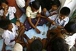 Cyclone Nargis survivors play at a temple turned into a makeshift refugee center in the town of Labutta, in Irrawaddy Division, May 10, 2008. Despairing survivors in Myanmar awaited emergency relief on Friday, a week after 100,000 people were feared killed as the cyclone roared across the farms and villages of the low-lying Irrawaddy delta region. The storm is the most devastating one to hit Asia since 1991, when 143,000 people were killed in neighboring Bangladesh. Photo by Eyal Warshavsky  *** Local Caption *** ëì äæëåéåú ùîåøåú ìàéì åøùáñ÷é àéï ìòùåú áúîåðåú ùéîåù ììà àéùåø