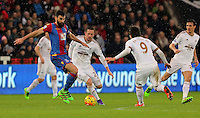 (L-R) Mile Jedinak of Crystal Palace against Gylfi Sigurdsson and Alberto Paloschi of Swansea during the Barclays Premier League match between Swansea City and Crystal Palace at the Liberty Stadium, Swansea on February 06 2016