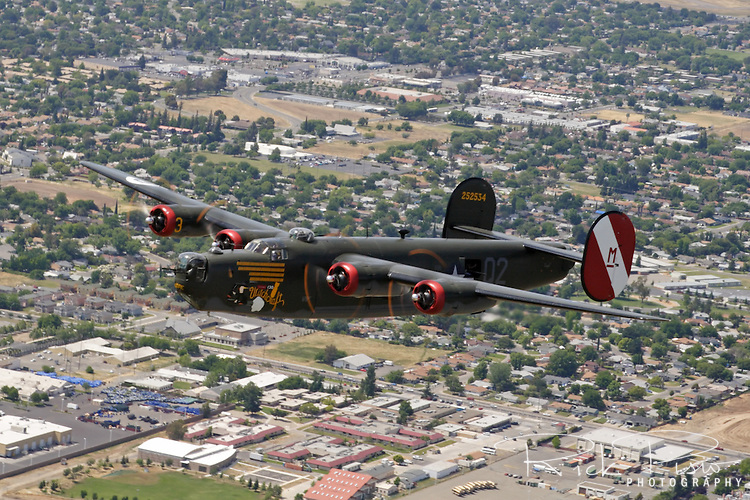 The last flying Consolidated  B-24 Liberator bomber flies over the Sacramento suburbs in California's Central Valley. Now owned and operated by the Collings Foundation th B-24 was originally built in 1944 by Consolidated Aircraft in Fort Worth, Texas. Originally delivered to the US Army Air Force it was later transferred to the Royal Air Force and saw combat in the Pacific Theater.