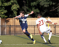 University of Rhode Island (URI) midfielder Matt Ribbens (13) works to clear ball. Boston College defeated University of Rhode Island, 4-2, at Newton Campus Field, September 25, 2012.