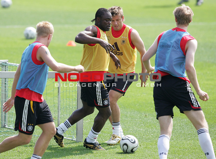 FIFA WM 2006 - Training - Germany<br /> Mike Hanke, Gerald Asamoah, Bernd Schneider and Per Mertesacker (l-r) with ball during a training session at the World Cup in Berlin (Stadion Wurfplatz). <br /> Foto &copy; nordphoto